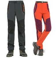 2021 Hombres de invierno Mujeres Pantalones de senderismo Pantalones al aire libre Softshell Pantalones impermeables a prueba de viento Térmico para acampar Escalada RM032