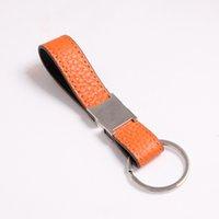 Fashion Keychain Designer Unisexe Chaîne de clé Véritable Cuir avec porte-clés en acier inoxydable Tye-clés en argent blanc noir