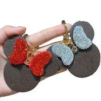 Llavero de lujo de diamante Keychain diseñado por los mejores diseñadores de cuero de alta calidad de cuero de alta calidad ratón de ratón regalo mujer bolsa colgante coche