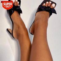 A empresa europeia e americana da empresa moda doce pequena fada arco de salto plana cruzam sandálias de tamanho grande # xn1c