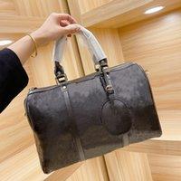 21SS Duffel Bags Travel Bag Женщина Сумочка из коровьей материала Два Цвета Высокая кабинета ZZL2104301