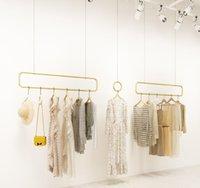 Tienda de ropa Exhibición de exhibición Muebles comerciales Muebles de pared Casa comercial Centro comercial Decoración de mujeres Luz de lujo Nano Gold Ropa Estante