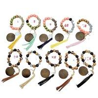 Kimter Leopard Wood Beads Pulsera Anillo de llaves con círculo de borla Llaveros Elásticos Elásticos Para Lady Bolso Colgante Joyería 2184 Q2