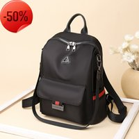 Student Backpack women's 2021 new fashion Korean Oxford spinning single shoulder canvas large capacity simple travel