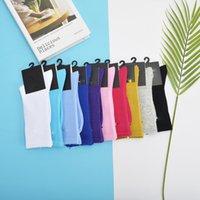 남성 양말 독립 포장 및 여성용면 긴 광고 솔리드 컬러 NK 후크 높은 튜브 스포츠 다기능