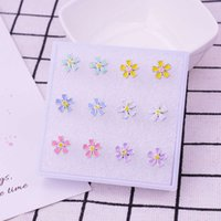 Pendientes de Chrysanthemum de YouMo Pequeña Margarita Coreana Flower Plástica Moda simple