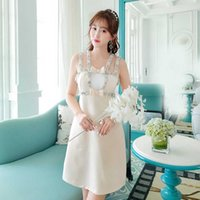 Spring and summer new women's heavy industry suspender skirt French temperament sexy open back nail bead inlaid diamond Miu dress best quality