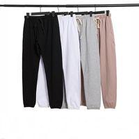 2021 Essentials com calças reflexivas homens mulheres desenhador longo calça primavera outono esportes correndo corredor tamanho grande tracksuit tamanho s-xl