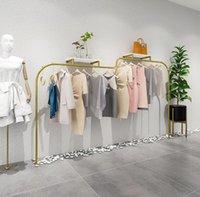 Giyim mağazası ekran raf duvar paslanmaz çelik tel fırçalanmış elbise raf basit yaratıcı kanca raylar