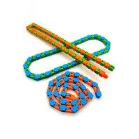 Toys coloré Puzzle Sensory Tracks Snap et clic sur Fidget Toys Kids Fidget Toys Toys Soulagement Rotation et forme 24 bits