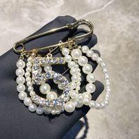 Fashion luxury glittering diamond number elegant pearl chain tassel pendant pin designer brooches for woman ladies