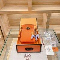 Sac à main Sac européen Sac en cuir de la gare Fashion Simple européen et américain Style Kelyss sac polyvalent un sac en forme de croix d'épaule xym