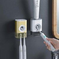معلقة معجون أسنان مصححة المنزلية للماء المثبتة على الجدار موزع أوتوماتيكي الحمام لحاملي فرشاة الأسنان