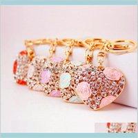 Accesorios de moda encantadora rosa corazón llaveros dulces llaveros cristal bolsa colgante cadenas titular anillos para la sala de coche llavero gota gota deli