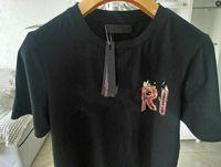 Designer Mens T Shirt T Shirt Crane de verano Diseñadores Camisas Fuego recto Negro Blanco Moda Hombres Mujeres Camisetas Algodón Hight Quality S-2XL