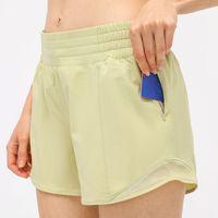 L11 Femmes Sports Shorts cachés Poche de poche de poche Courte Pantalon Court Pantalon Outfit Lâche Respirable Casual Sportswear Filles Exercice Fitness usure