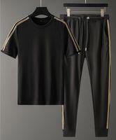 Avrupa ve Amerikan Moda Pantolon Tasarımcı İlkbahar Yaz erkek Spor Rahat Takım Kısa Tshirt Uzun M-4XL NK010