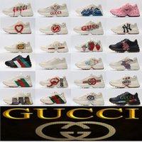Gucci Rhyton Vintage Leather Sneaker Sneaker Casual Scarpe da uomo Designer con Strawberry Wave Bocca Tiger Web Stampa Tipis Luxury Trainer Donne scarpe a forma di corno