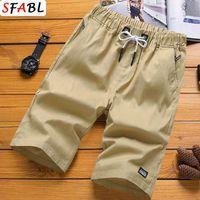 Sfabl Hommes Shorts Noir Solid Sumle Summer Sece Sece à la taille Élastique Taille Ziplan Poche Casual Court Pant Homme Shorts Plus Taille 5XL 210720
