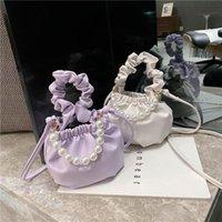 أزياء المرأة حقائب اليد حقيبة الكلاسيكية الملمس حساسة تصميم الإبداعي أنيقة اللؤلؤ مصغرة جلد مطوي حبال حقيبة الكتف الصغيرة الصليب الجسم