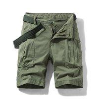 Hommes Été Nouveau short occasionnel Mode Couleur Solide Couleur Multi-poche Pantalons de cargaison Shorts de grande taille Micro-élastique Shorts mâle 29-36