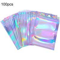 100pc / pack Bolsa de plástico reclimable iridiscente de aluminio Papel de aluminio Orificios de agua Holograma Pollozo de cremallera de almacenamiento Envapa de regalo de embalaje