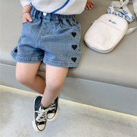 أزياء أطفال الدينيم السراويل الصيف الفتيات الحب القلب القصيرة الجينز الأطفال بطة هول عارضة كاوبوي الملابس A6320