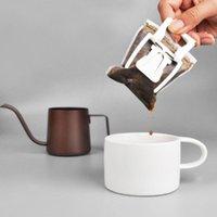 Filtros de café 50pcs / lote 7.4 * 9cm Polvo portátil Bolsa de filtro de polvo Drip Papel Ear Ear