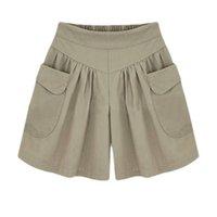 Summer Moda Mujeres Elástica Cintura Suelta Pantalones cortos negros Todo juego Pantalones cortos de bolsillo casual integrados Talla grande 6XL S913 Mujeres