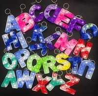パーティーの賛美26文字の綴りバブルキーホルダーFidget Toys親子インタラクティブ教育玩具