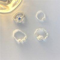 Joyería hecha a mano Wholesale Anillo de flor de perla gentil coreano, anillo con cuentas superpuestas, cuentas de arroz tejidas, anillo de cuerda elástica ajustable