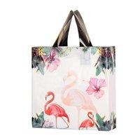 선물 포장 50pcs 다채로운 플라스틱 쇼핑백 핸들 패션 부티크 옷 포장 가방 25x30x8cm