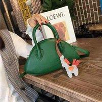 Großhandel Mode Dumpling Damen Tasche, Nette und süße Art, Rot, Schwarz, Grün, Lila für Ihre Wahl