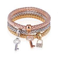 Blocco chiave di moda intarsiato con diamante mais a catena strato elastico tre tuta colore braccialetto
