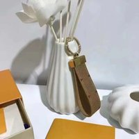 2021 fashion luxury designer keychains for Womens and Mens Sublimation Blanks keychain Alloy Leather Flowers Car key ring lover keys rings