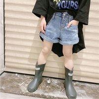 أزياء الصيف ارتداء السراويل كاوبوي النسخة الكورية نمط الأجنبية فتاة قصيرة رقيقة جيوب الجبهة تصميم الأطفال السراويل 19 6BX T2