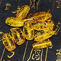 Altro 1 pz / lotto Pure Natural Golden Giallo Giallo Amber Perle scolpite 9 Eye Pattern Tibetano Stile Buddista Dzi Brancio Menwomen Gioielli FAI DA TE