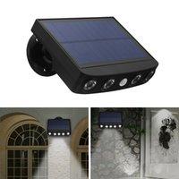 Toptan Toplu Güneş Hareket Sensörü Işık Açık Güvenlik Lambası Güneş Enerjili Aydınlatma Su Geçirmez Dış Duvar Işıkları 4LED Ampul Ön Kapı Çit Yard Garaj Veranda