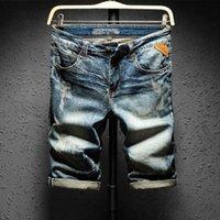 Shanbao Trend Men's Estate New Denim Style Retro Style Vecchio Designer in pelle sottile foro dritto in cotone jeans pantaloncini