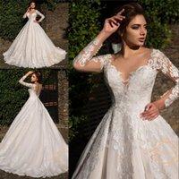 2021 Robe Magnífico vestido de bola de encaje Vestidos de novia Mangas largas con cuello en V cuello de espalda con encanto Dubai Dubai vestido de novia hecho a medida