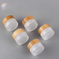 Botellas de almacenamiento JARS OEM ODM Impresión grabada Logo Cosmetic 5ml 15ml 30ml 50ml 100 ml Tarro de cristal congelado transparente con la tapa de madera de bambú para B
