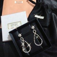 Mujeres Diamante cuelga Pendientes extravagantes Crystal Ear Studs Pendiente Personalidad Diseñador Dama Joyería de alta calidad
