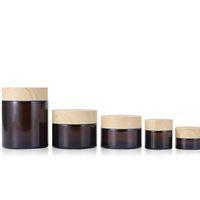 Bouteille d'ambre bouteille cosmétique de visage vides Crème de stockage conteneur échantillon rechargeable avec couvercles de grains en bois en plastique