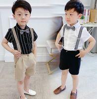 الصيف الأولاد الأداء مجموعات الاطفال التلبيب قصيرة الأكمام قميص + شريط الحمالة السراويل + منقوشة الانحناء التعادل 3 قطع الصبي الملابس A6901