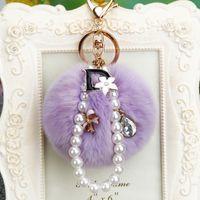 Lavendelpelz Kugel Schlüsselanhänger Schmuck Strass Charms Blumenklee Schlüsselanhänger Ringe Halter Zubehör Mode Frauen Imitation Pearl Bag Anhänger Autos Schlüsselring Geschenk