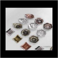 Conjuntos de café 50 pcs Creative Metal Bandejas Placa de Insulação Placa de Placa de Bule Protetor de Tabela Folha Folha Ferramentas de Chá Q8TFJ VDMJV
