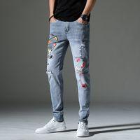2021 trendy men's fashion jeans college boy tight runway straight zipper denim ragged pants light blue European and American trousers