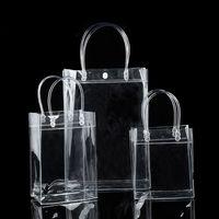 التعبئة مكتب المدرسة الأعمال الصناعية المحدودة 10pcs / lot الشفافية pvc هدية حمل أكياس تغليف مع حلقة اليد، حقيبة يد البلاستيك واضحة
