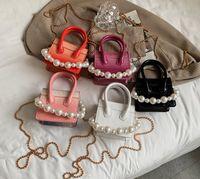 Diseñador niños grandes perlas cadenas bolsos de lujo niñas piedra grano mensajero princesa bolsa niños bolsas de un hombro de un hombro moda mujer lápiz labial claves clave Q0289