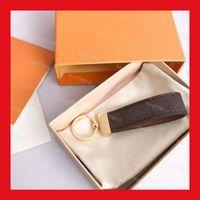 Porte-clés en cuir de luxe en cuir de voiture de luxe Femme Mens Homme Mignon Haute Qualité Golden Key Chain